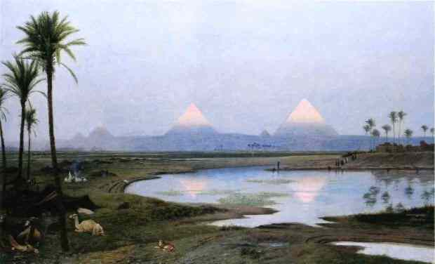 From across the Nile the tips of the Pyramids glow brightly, while the remainder is veiled in mist.